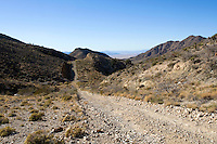 A dirt road running through the Mojave Desert, California.