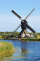 Authentic working windmill at Kinderdijk UNESCO World Heritage Site, dykes and polder, Holland, The Netherlands