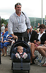 26 August 2006: Julie Foudy's husband, Ian Sawyer, and daughter, Izzy, make their way to their seat. The National Soccer Hall of Fame Induction Ceremony was held at the National Soccer Hall of Fame in Oneonta, New York.
