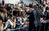 United States President Barack Obama and Prime Minister Justin Trudeau of Canada shake hands with guests during an Arrival Ceremony on the South Lawn of the White House in Washington, DC on Thursday, March 10, 2016. <br /> Credit: Olivier Douliery / Pool via CNP