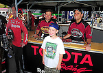 Jun. 17, 2011; Bristol, TN, USA: NHRA top fuel dragster driver Larry Dixon (right) and teammate Del Worsham pose with fans during qualifying for the Thunder Valley Nationals at Bristol Dragway. Mandatory Credit: Mark J. Rebilas-