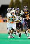 10 April 2011: University of Vermont Catamount F/O Tom Frasca, a Senior from Medfield, MA, in action against the University at Albany Great Danes on Moulton Winder Field in Burlington, Vermont. The Catamounts defeated the visiting Danes 11-6 in America East play. Mandatory Credit: Ed Wolfstein Photo