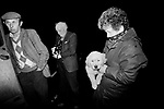 Puppy Farming Wales Carmarthen. 1989. Licensed and unlicensed dog breeders bring their puppies to Tony Yeomans who is a licensed dealer, he operates from the back of a large transit van from various 'last minute' pick up points around the town.