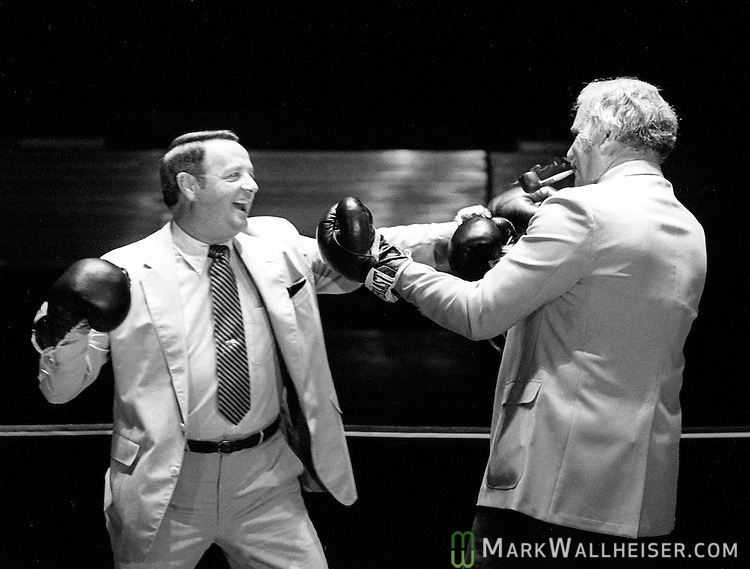 Florida State's Bobby Bowden, left, and Miami's Howard Schnellenberger square off in the boxing ring to promote the FSU- Miami game November 7 ,1983.  Miami defeated FSU 17-16. (Mark Wallheiser/TallahasseeStock.com)
