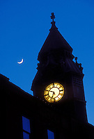 A crescent moon and the historic Savings Bank building in downtown Marquette, Mich. at dusk.
