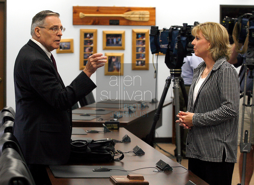 Laura Mallory (right), a mother from Loganville, Ga., speaks to hearing officer L.O. Buckland at the Georgia Board of Education before a hearing in her effort to have &quot;Harry Potter&quot; books removed from the shelves in Gwinnett County public schools. Mallory argued that the books &quot;promote the particular religion of witchcraft&quot; and that children practice spells from the books. &quot;You would think we'd want to do everything we can to remove evil from our schools,&quot; she said. Mallory said that she has never read in full any of the &quot;Harry Potter&quot; books. Buckland will make a recommendation to the State Board of Education, but he did not say when that will occur.<br />