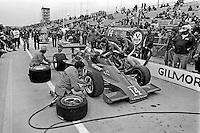 INDIANAPOLIS, IN - MAY 27: Crew members for AJ Foyt's Parnelli VPJ6C 005/Cosworth TC practice a pit stop before the Indy 500 at the Indianapolis Motor Speedway in Indianapolis, Indiana, on May 27, 1979.