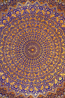 Detail of ceiling decoration, Tillyah-Kori Madrasah, 1646-60,Registan, Samarkand, Uzbekistan, pictured on July 15, 2010, in the morning. The Tillyah-Kori (gilded) Madrasah is part of the Registan Ensemble, surrounding a magnificent square. Commissioned by Yalangtush Bakhadur it is not only a school but also the grand mosque whose lavishly gilded main hall in Kundal style justifies the name. Samarkand, a city on the Silk Road, founded as Afrosiab in the 7th century BC, is a meeting point for the world's cultures. Its most important development was in the Timurid period, 14th to 15th centuries. Picture by Manuel Cohen.