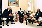 United States President Ronald Reagan, center, meets during the evening of September 17, 1987 in the White House Residence with Soviet Foreign Minister Eduard Shevardnadze, left, and U.S. Secretary of State George Schultz, right.<br /> Mandatory Credit: Bill Fitz-Patrick / White House via CNP