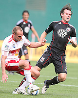 Carey Talley #8 of D.C. United is tackled by Joel Lindpere #20 of the New York Red Bulls during an MLS match on May 1 2010, at RFK Stadium in Washington D.C.