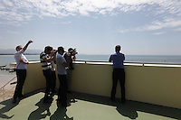Photographers flock around Minister of the Environment and International Development, Erik Solheim, during a visit to Khao Lak, north of Phuket. The area was severley hit by the Tsunami that struck Asia 26/12/2004.The area has since been rebuilt, and tourists have returned. A tower has been built on the beach as a tsunami shelter. .&copy;Fredrik Naumann/Felix Features.