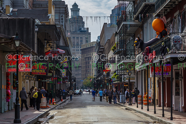 Visitors and tourists walk down Bourbon Street in the French Quarter of New Orleans, Louisiana.