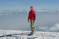 Gulmarg, Kashmir. The stunning vista of the winter Himalayas provides the backdrop for a young russian snowboarder at the top of the Gulmarg gondola (3980m). The gondola which opened in 2005 is the worlds highest and has been drawing snowboarders and skiers from around the world. Gulmarg is only 10km from the line of control that seperates Pakistan Kashmir from Indian Kashmir which means its situated in a conflict area. But improved relations between the two countries as well as a peace process within Kashmir have meant more skiers are now flocking to the area for what is said to be some of the best skiing in the world.