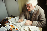 Portrait of author and artist Alfred Wainwright in the Lake District in his upstairs spare bedroom cum office Circa 1970.