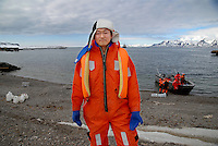 "photograph by XAVIER CERVERA 06/2010.Ny-Ålesund (""New Ålesund"") is one of the four permanent settlements on the island of Spitsbergen in the Svalbard archipelago. It is located on the Brøgger peninsula at Kongsfjorden. Like the rest of Svalbard, Ny-Ålesund is administered by the Kingdom of Norway..Ny-Ålesund is one of the world's northernmost settlements at 78°55?N 11°56?E; and is the world's northernmost functional public settlement..Today, it is inhabited by a permanent population of approximately 30-35 persons. All of them work for one of the research stations -- e.g. the Global Atmosphere Watch -- or the logistics and supply company ""Kings Bay AS"", which 'owns' and runs the research village. In the summer the activity in Ny-Ålesund is greatly increased with up to 120 researchers, technicians, and field assistants. At present, Norway, the Netherlands, Germany, United Kingdom, France, India, Italy, Japan, South Korea and China all maintain research stations at Ny-Ålesund, although not all are inhabited year-round..A chinese sciencist, Zhang Rui, from Xiamen University (Fujian province, south east China) looking at Arctic weather from Yellow River Station in the middle of Ny-Alesund science village"
