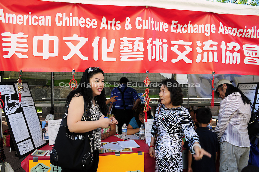 Mesa, Arizona. November 4, 2012 - The booth of the American Chines and Culture Exchange Association offered information to festival attendees during the 18th Annual Asian Festival 2012 that took place at the Mesa Arts Center in Mesa, Arizona. In Arizona, Asian-Americans celebrated a colorful festival where their rich culture was admired and their growing presence affirmed. Asian-Americans are now the United States fastest-growing racial group, the best-educated and highest-earning workers. Photo by Eduardo Barraza © 2012