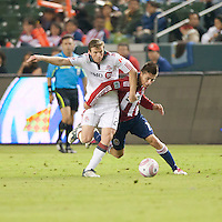 CARSON, CA – OCTOBER 9: Toronto FC midfielder Jacob Peterson (23) and Chivas USA midfielder Jorge Flores (19) during a soccer match at Home Depot Center, October 9, 2010 in Carson California. Final score Chivas USA 3, Toronto FC 0...