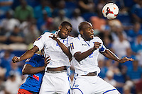 Honduras defender Johnny Palacios (4) and defender Osman Chavez (2) go up for a header. Honduras defeated Haiti 2-0 during a CONCACAF Gold Cup group B match at Red Bull Arena in Harrison, NJ, on July 8, 2013.