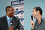 Former England football stars Viv Anderson and Martin Keown share a joke at Wembley Stadium