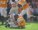 Tennessee tailback Tauren Poole (28) is dropped for a loss by Ole Miss defensive tackle Lawon Scott (96) in a college football game at Neyland Stadium in Knoxville, Tenn. on Saturday, November 13, 2010. Tennessee won 52-14.