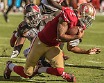 San Francisco 49ers quarterback Colin Kaepernick (7) runs for first down on Sunday, October 23, 2016, at Levis Stadium in Santa Clara, California. The Buccaneers defeated the 49ers 34-17.