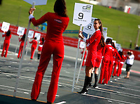 Grid Girls waiting for the Car of the GP Asia Series to form in the grid