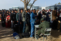 Ras Ajdir, Feb 26, 2011.Thousands of refugees, mostly Tunisians but also Egyptians and Libyans flee the ongoing revolutions and blood fights inside Libya.