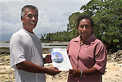 Koin Etuatiu (on right), Greenpeace Australai Fiji Climate Change campaigner , presents a Greenpeace booklet to HIs Excellency President of Kiribati Anote Tong ( on left), after an interview with the preseident in which he was asked about Kyoto Protocol, Climate change and the Kiribati situation.