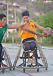 Alejandro Jarquin (left) tries to steal the ball from Roel Hernandez during practice in Zipolite, a town in Oaxaca, Mexico. Jarquin and Hernandez play on the Oaxaca Costa wheelchair basketball team.