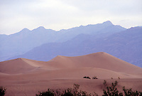 DEATH VALLEY<br /> (Variations Available)<br /> Sand Dunes<br /> Wind blown sand forms dunes through saltation<br /> <br /> Sand grains bounce as they are moved by the wind, displacing other grains to form ripples. In time the ripples grow to ridges and eventually dunes.