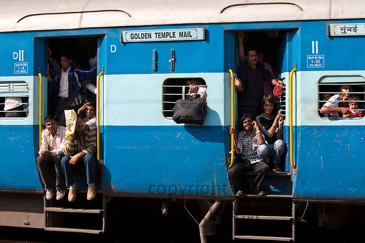Indian people on crowded train at Bharatpur Station, Northern India