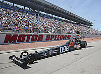 Apr 11, 2015; Las Vegas, NV, USA; NHRA top fuel driver Larry Dixon being towed down the return road during qualifying for the Summitracing.com Nationals at The Strip at Las Vegas Motor Speedway. Mandatory Credit: Mark J. Rebilas-