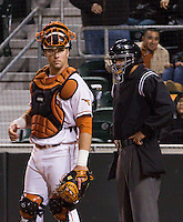University of Texas catcher Cameron Rupp glares at the UT Pan American dugout after tagging their runner out at home.