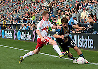 CHESTER, PA - OCTOBER 27, 2012:  Antoine Hoppenot (29) of the Philadelphia Union tries to get by  Dax McCarty (11) of the New York Red Bulls during an MLS match at PPL Park in Chester, PA. on October 27. Red Bulls won 3-0.