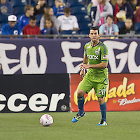 Seattle Sounders defender Zach Scott (20) looks to pass. In a Major League Soccer (MLS) match, the Seattle Sounders FC defeated the New England Revolution, 2-1, at Gillette Stadium on October 1, 2011.