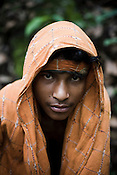 Bhimo Pusika poses for a portrait in the jungles around Salpojola village in Niyamgiri hills. He is one of the many people who will get displaced if the aluminium company Vedanta carries on with its plans of mining of Bauxide in Niyamgiri hills in Rayagara district of Orissa in India.