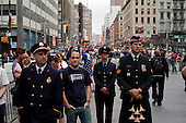 New  York, New York.September 11, 2011..Crowds gather at Church Street and Vesey Street, one block from   Ground Zero, to mark the 10th anniversary of 9-11-2001 tragic attack on the US. The entire area was under extremely heave police presents during the day. Visitors listen as the names of the more then three thousand victims, who died on that day, are read.