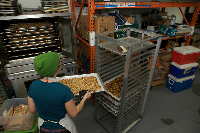 Fresh baked granola cools before being packaged.