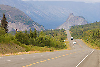 Recreational vehicles travel the scenic Glenn Highway in southcentral, Alaska. King Mountain of the Chugach Mountain range in the distance.