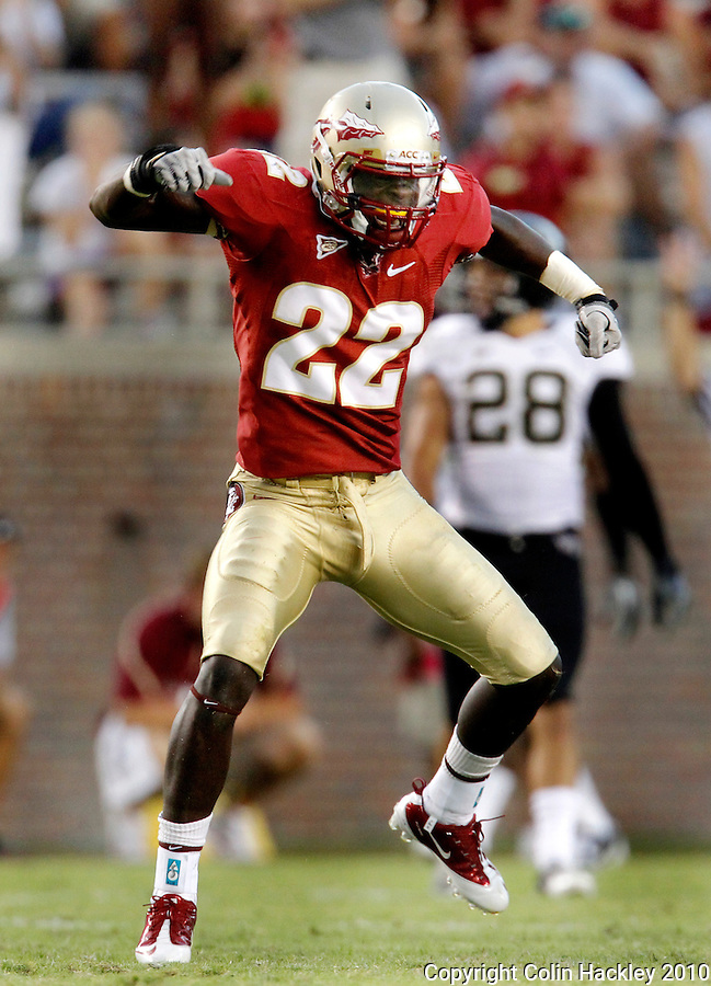 TALLAHASSEE, FL 9/25/10-FSU-WF FB10 CH-Florida State's Telvin Smith celebrates a tackle against Wake Forest during second half action Saturday at Doak Campbell Stadium in Tallahassee. The Seminoles beat the Demon Deacons 31-0..COLIN HACKLEY PHOTO