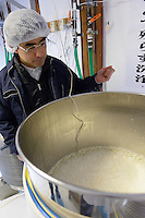 Brewery president Niichiro Marumoto with a tank of fermenting sake starter. Marumoto Sake Brewery, Asakuchi city, Okayama Pref, Japan, January 28, 2014. Okayama is famous for its earthy full-bodied sake. In January and February 2014 a 5-day tour of breweries in the prefecture was organised by Sake Brewery Tours (www.saketours.com).