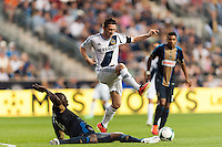 Bakary Soumare (4) of the Philadelphia Union goes for a tackle on Robbie Keane (7) of the Los Angeles Galaxy. The Los Angeles Galaxy defeated the Philadelphia Union 4-1 during a Major League Soccer (MLS) match at PPL Park in Chester, PA, on May 15, 2013.