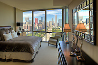 Master bedroom with magnificent view onto Chicago's skyline in one of the units of Museum Place in Chicago. The development blends energetic architectural forms with postmodern materials to create a design which elevates Chicago's world-class architectural reputation. Floor-to-ceiling windows, lively diagonal expressions and exposed steel elements are the hallmarks of Museum Park Place and combine to create a building whose composition is unlike any other on Chicago's lakefront. Contructed by Lend Lease and designed by Pappageorge Haymes Partners.