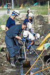 Police dig mud from the drains in search of human remains outside Okawa elementary school  in Ishinomaki Prefecture, Japan on 08 Sept. 2011.  Photograph: Robert Gilhooly