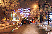 A small tractor with a snow blower doing snow removal in city of Joliette,Quebec