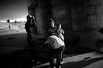 Family curses at U.S. Border Patrol at the scene of the murder of a 15 year-old boy, who was killed by a U.S. Border Patrol agent in Ciudad Juarez, Chihuahua on June 7, 2010 after he had tried to cross.