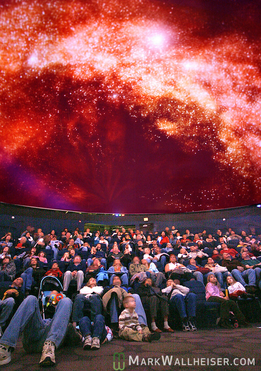 "Tallahassee families watch the free show ""Learning the Night Sky"" at the Downtown Digital Dome Theater and Planetarium at the Challenger Learning Center January 5, 2008.    (Mark Wallheiser/TallahasseeStock.com)"