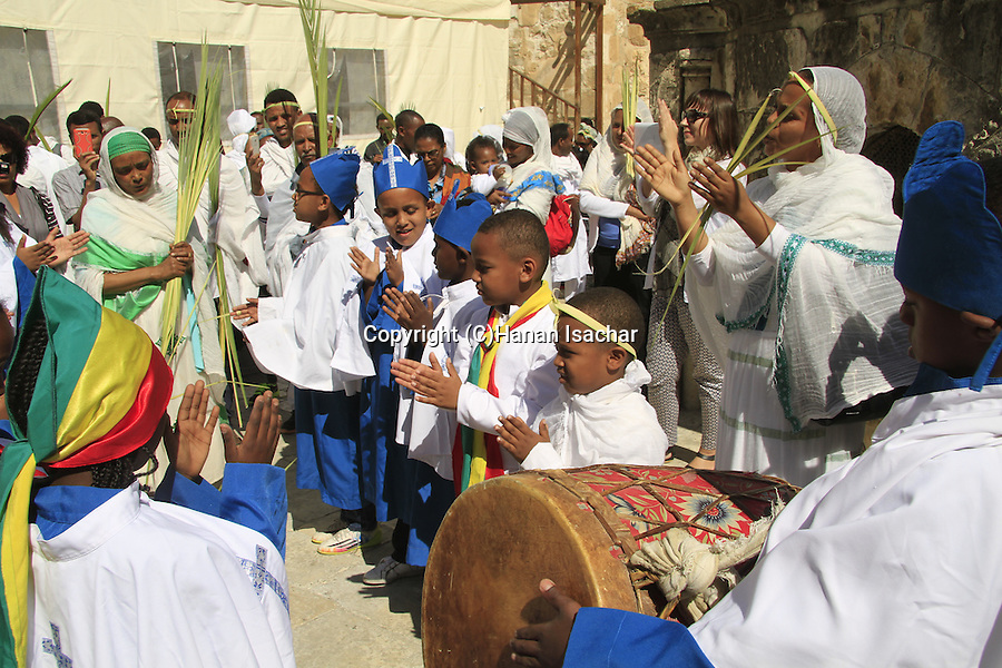 Israel, Jerusalem, Ethiopian Orthodox Palm Sunday procession around the dome of St. Helena Chapel at the Church of the Holy Sepulchre