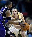 Seattle Supersonics' Vladimir Radmanovic of Serbia-Montenergo, R, guards Sacramento Kings'  Cuttino Mobley in the first period  of their  Western Conference First Round Game #2 at Key Arena in Seattle, Washington Thursday, 21 April  2005.   Jim Bryant Photo. &copy;2010. All Rights Reserved.