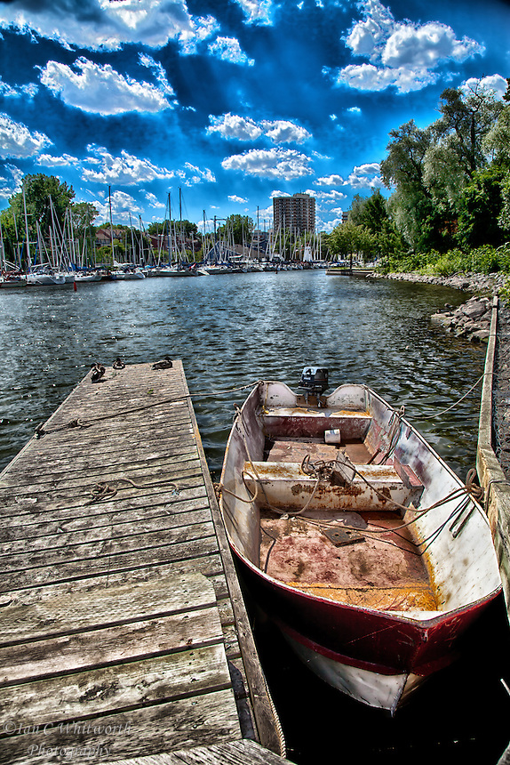 looking at a boat against a dock in Oakville Harbour in a Photo Art style.